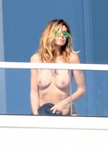 Heidi Klum Goes Topless on a Balcony for Her MILF War Entry