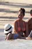 Jessica Alba Returns to the Beach – Brings the Alba Pose