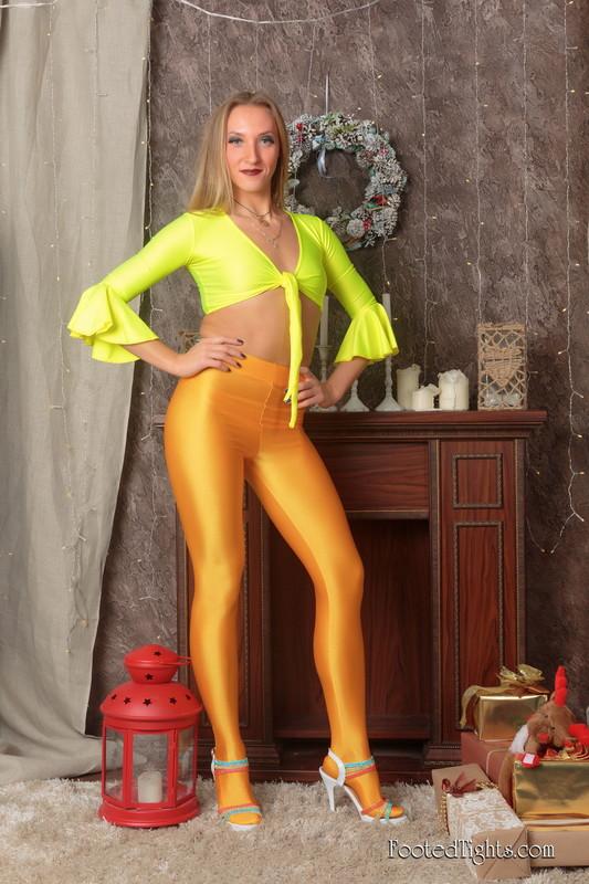 blonde woman Irina G in orange spandex pants & high heels