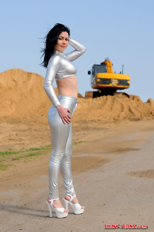 horny lady Teinara in silver skin tight outfit