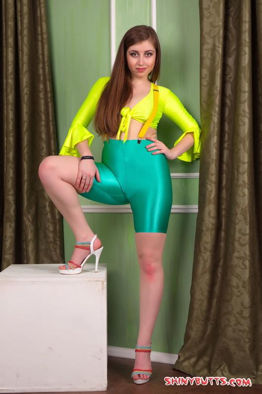 pretty model Valya in green yoga shorts & sexy high heels