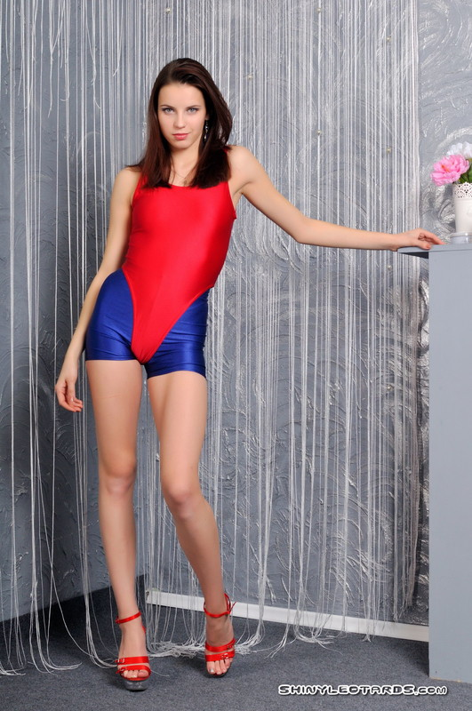 slavic babe Ulyana in blue spandex shorts & red swimsuit