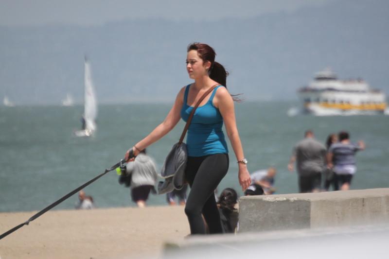 hot dog walking girl in yoga pants