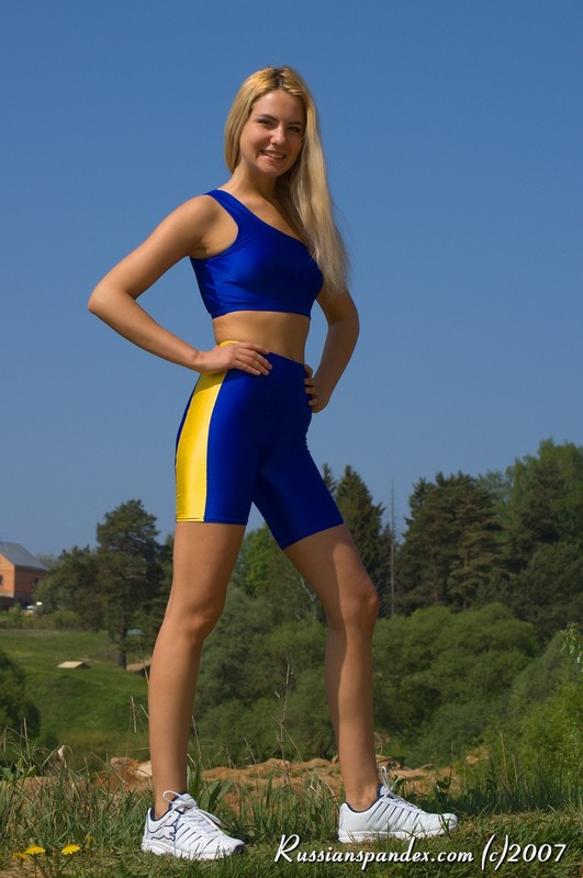 pretty slavic blonde teen in shiny workout outfit