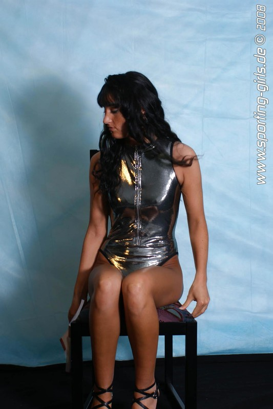 german babe Semia in shiny silver 1 piece swimsuit