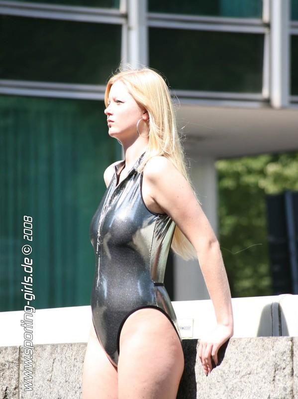 hot blonde Saskia in shiny 1 piece swimsuit