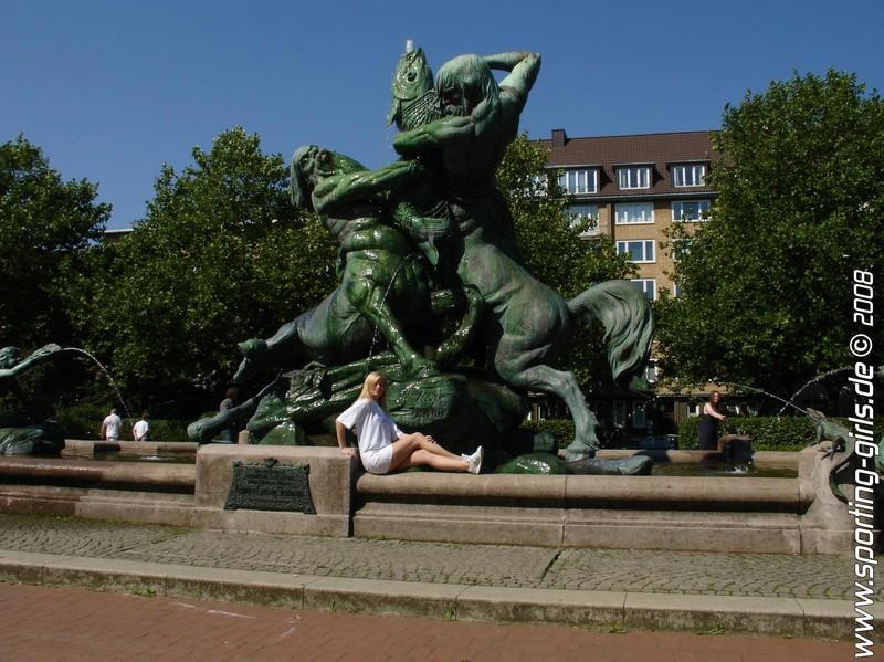 fountain girl Saskia in speedo 1 piece swimsuit