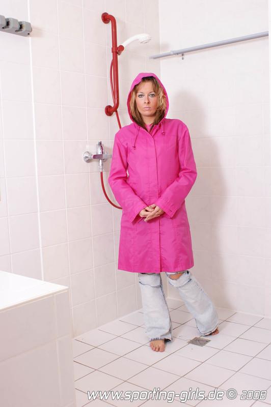 mature bathroom chick Magda in jeans & pink speedo swimwear