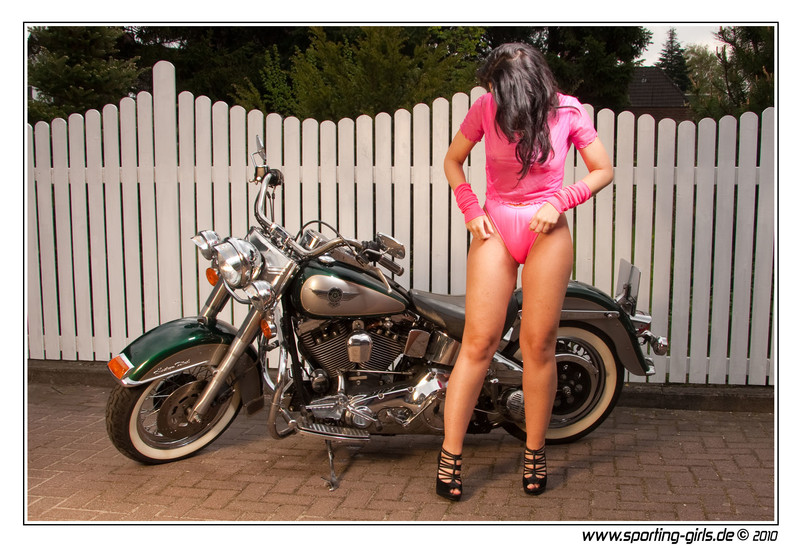 swimsuit model Angelina showing her motorbike