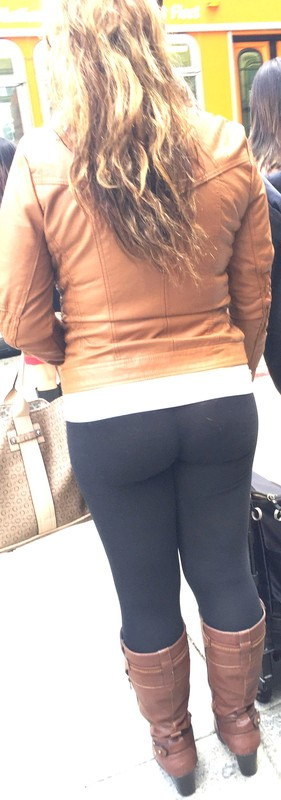 college female in black leggings & leather boots
