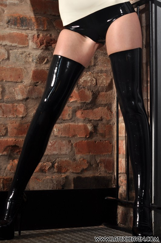 dominatrix Sarah in kinky rubber outfit