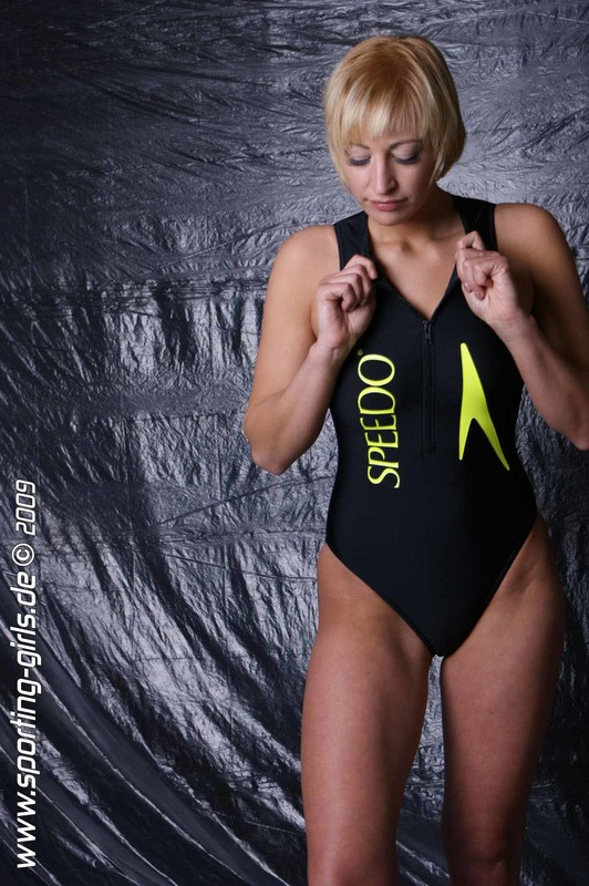 blonde woman Chrissy in speedo 1 piece bathing suit