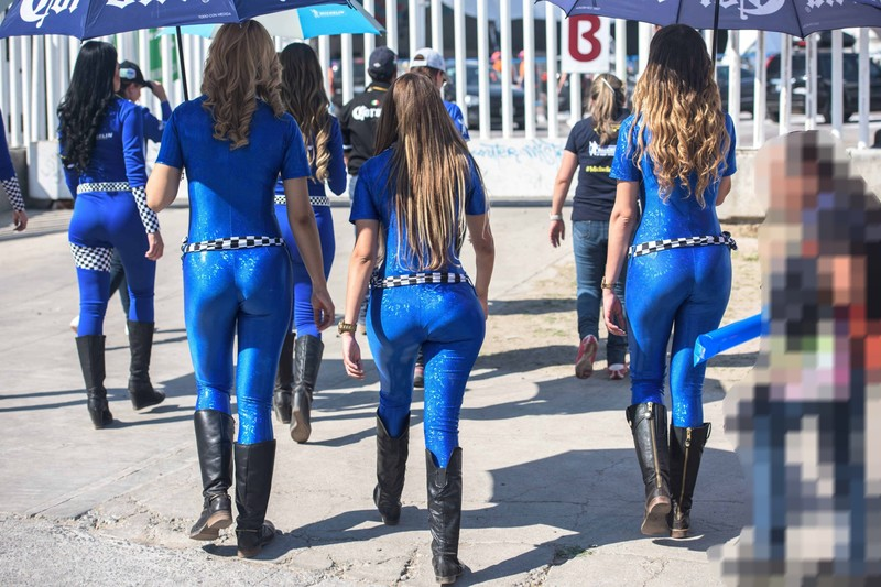 horny promo girls in shiny blue catsuits