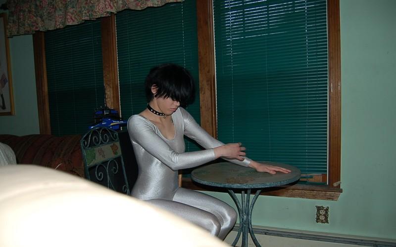 brunette model Gina in grey catsuit