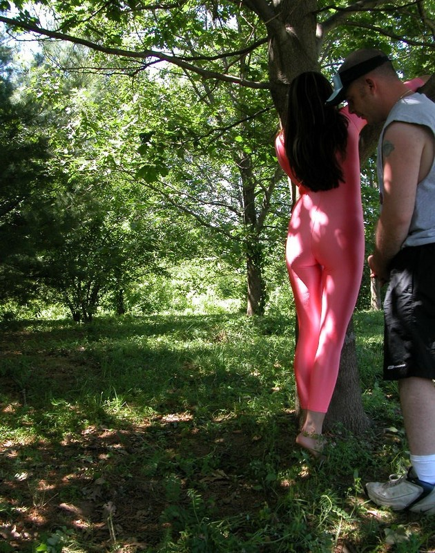 forest girl Lexi in red shiny catsuit