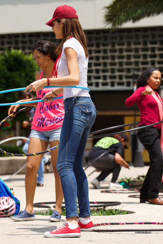 hula hoop chick in tight blue jeans