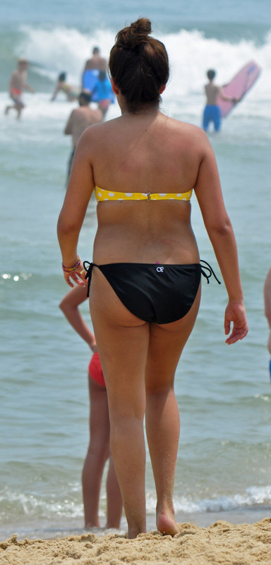 lovely babe in wet strapless bikini