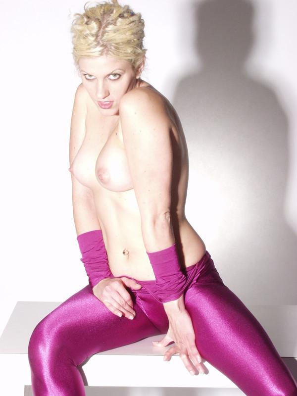 blonde model Paula in purple catsuit