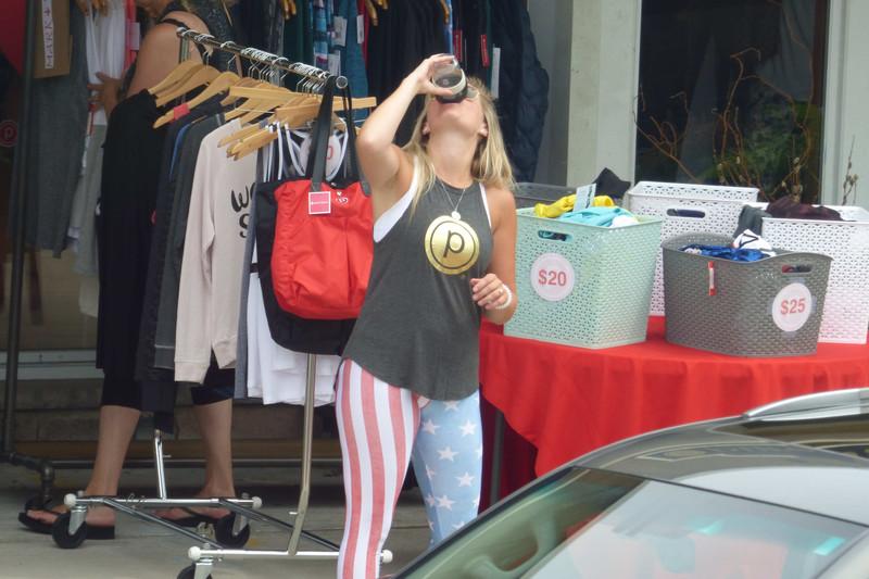 blonde woman in kinky stars & stripes leggings