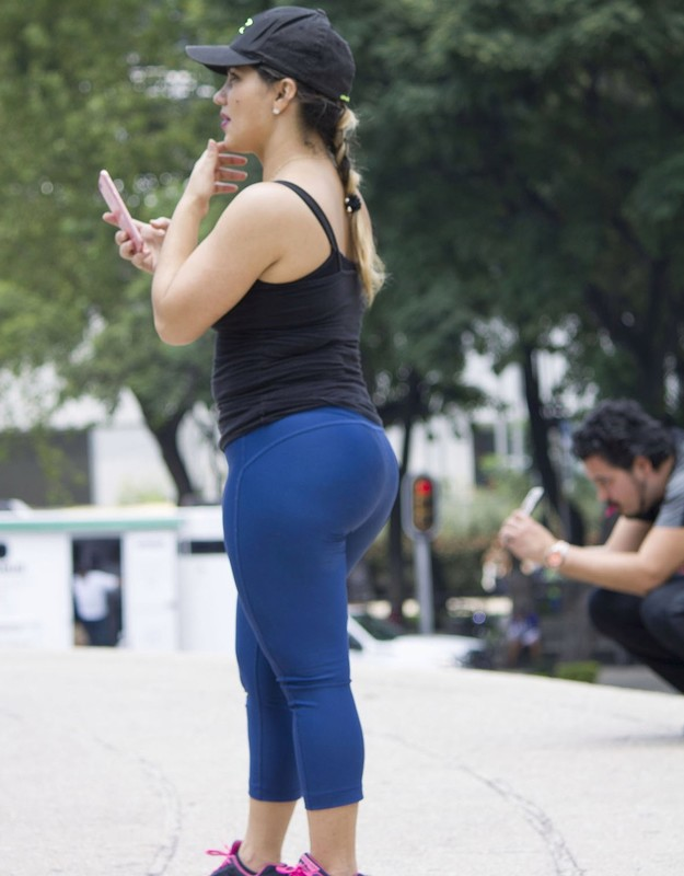 handsome lady in blue yogapants