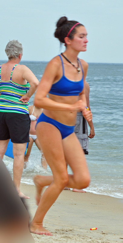 beach jogger lady in blue bikini