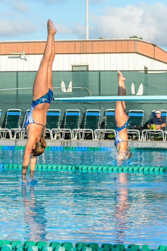 water jumping ladies in wet swimsuits