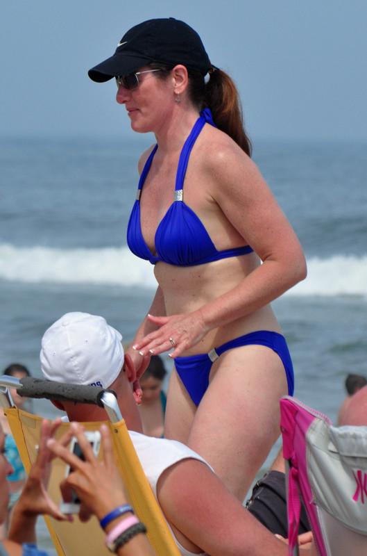 handsome milf in blue bikini & baseball cap